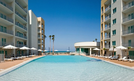 Stay with Daily Breakfast at Peninsula Island Resort in South Padre Island, TX. Dates into December.