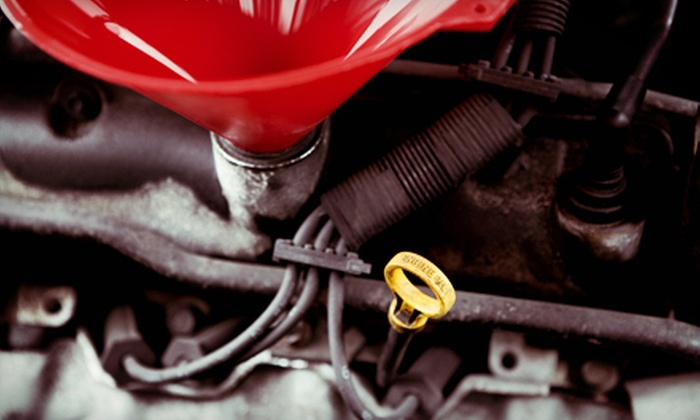 Neul's Springs, Chassis, and Auto Glass - Winnipeg: Oil-Change Package or Windshield Repair for One or Two Chips at Neuls Springs, Chassis & Autoglass (Up to 64% Off)