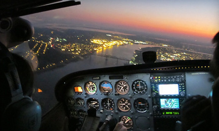 Flight Academy of New Orleans - New Orleans: Orientation to Flight Lesson, or 45-Minute Big Easy Aerial Tour for Two from Flight Academy of New Orleans (Half Off)