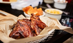 The South Paw: Smoked Wings, Pizza, and More for Two or Four at The South Paw (Up to 60% Off)