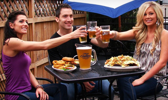 Tom Reid's Hockey City Pub - Tom Reid Hockey City Pub: Burgers and Beer or Wine for Two or Four at Tom Reid's Hockey City Pub (52% Off)