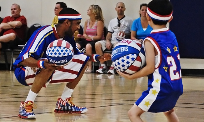 Harlem Globetrotters Summer Basketball Clinic - 24 Hour Fitness- Overland Park: $55 for a Two-Hour Kids' Harlem Globetrotters Basketball Clinic and Two Tickets to a 2015 Game (Up to $111 Value)
