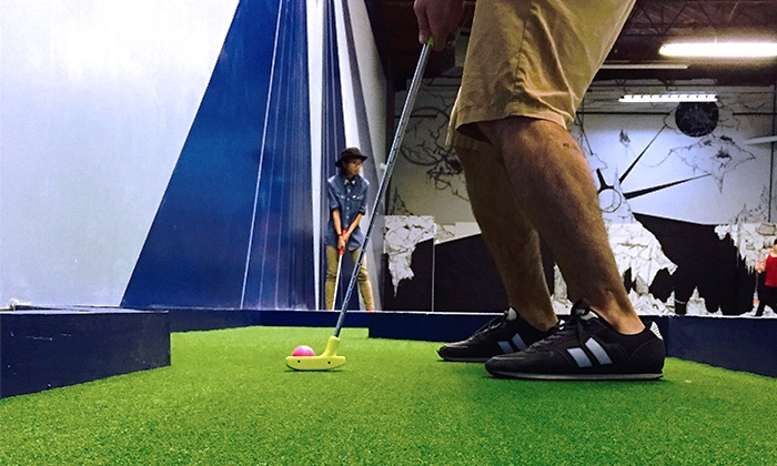 West Coast Mini Putt - City Centre: 18 Holes of Blacklight Mini Golf for Two or Four at West Coast Mini Putt (Up to 46% Off)