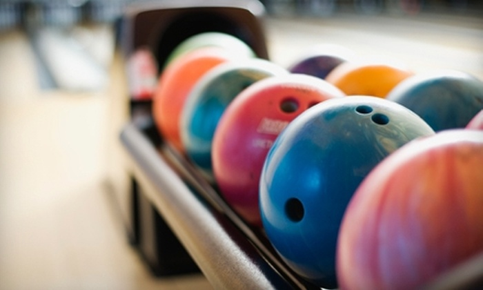 Sunset Lanes - Central Beaverton: $25 for Bowling for Four with Shoe Rental, Large Pizza, and $10 Worth of Arcade Games at Sunset Lanes (Up to $63.79 Value)
