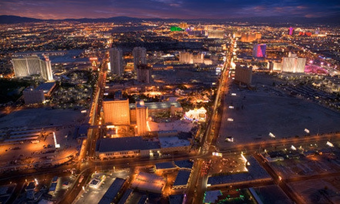 Elite Aviation - North Las Vegas Airport: $144 for a Helicopter Tour of The Strip and a Vegas Show for Up to Three from Elite Aviation ($289 Value)