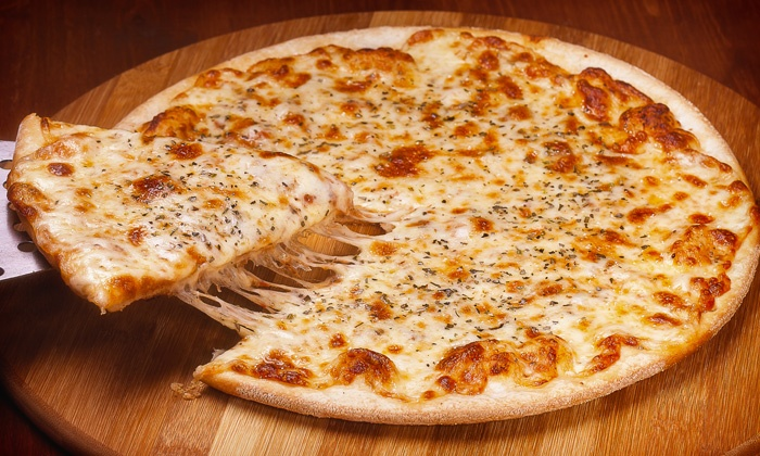 Ralph's Pizza - Far North Dallas: $20 Toward Lunch or Large, 3-Topping Pizza with Cheesy Garlic Bread and Soda at Ralph's Pizza (Up to 36% Off)