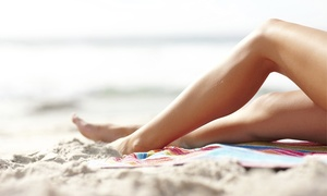 Blow Dry Style Lounge: One, Three, or Five Beach Bronze Spray Tans with a Complimentary Drink at Blow Dry Style Lounge (Up to 57%Off)