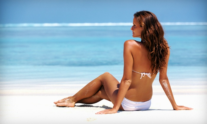 The Sun Oasis Tanning Center - Auburn Hills: UV Tans, Spray Tans, or Three or Six Fit Body Wraps at The Sun Oasis Tanning Center in Auburn Hills (Up to 70% Off)