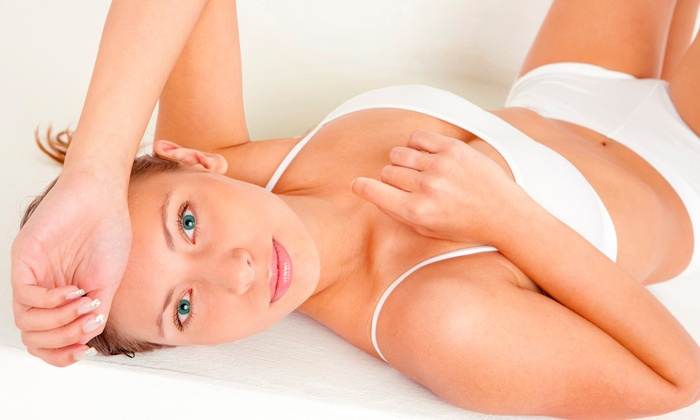 Hot Spot Tanning - Multiple Locations: Two or Four Custom Spray Tans at Hot Spot Tanning (Up to 37% Off)