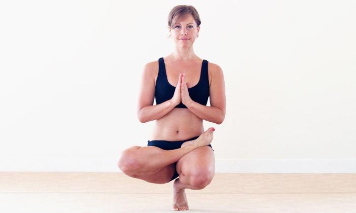 Bikram Yoga Huntington Beach - Huntington Beach: $49 for 10 Yoga Classes or One Month of Unlimited Classes at Bikram Yoga Huntington Beach ($180 Value)