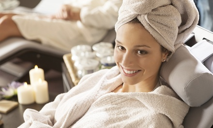 $39 for a Spa-Day Package with Relax Massage, Glow Tan, and Renewal Facial at Planet Beach ($128 Value)