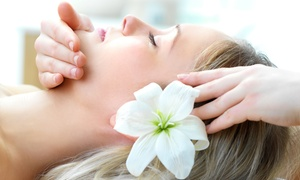 Spa Logic: $164 for a Spa Package with Massage, Mani-Pedi, Facial, and Complimentary Wine at Spa Logic ($295 Value)