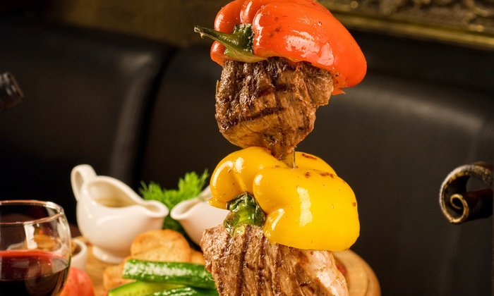 The Gaucho Brazilian Steakhouse - Key: Churrasco-Style Dinner for Two, Four, or Six at The Gaucho Brazilian Steakhouse (Half Off)