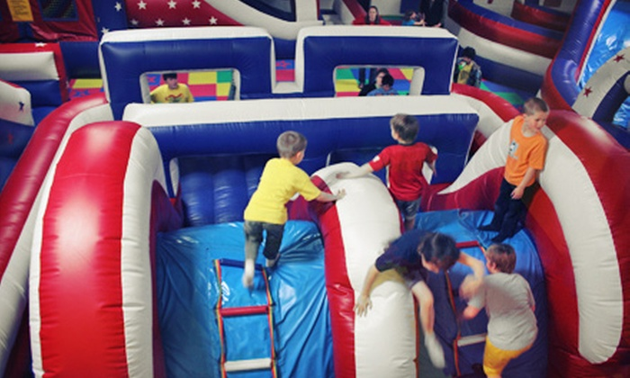Bouncy Town USA - Windsor: Four Play Sessions for One or Two, or a Bounce Party for Up to 14 with Pizza at Bouncy Town USA (Up to Half Off)