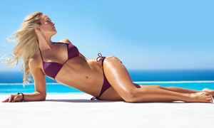 At The Beach Tanning: Airbrush Tans at At The Beach Tanning (50% Off). Three Options Available.
