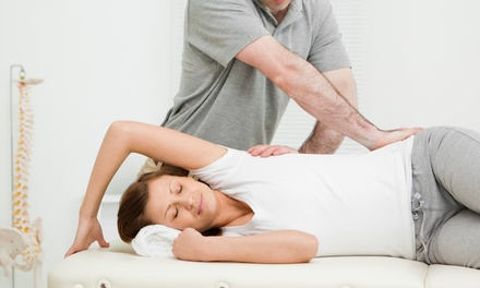 Chiro Exam, Acupuncture or Massage, and Adjustment at Booth Chiropractic and Acupuncture (Up to 73% Off)