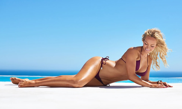 Darque Tan  - Multiple Locations: Two Spray Tans or Five UV Tans at Darque Tan (Up to 72% Off)