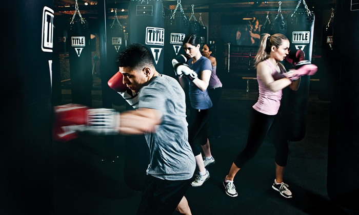 TITLE Boxing Club - Alpharetta - Alpharetta: $29 for Two Weeks of Boxing and Kickboxing Classes, Including Handwraps at TITLE Boxing Club ($75 Value)