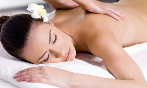 White Raven Spa Company: Aromatherapy Massage or Hot Stone Anti-Cellulite Massage at White Raven Spa Company (Up to 67% Off)