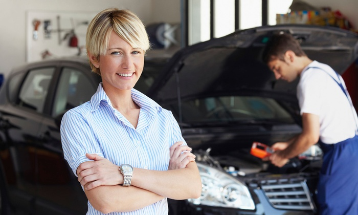 J&M Auto Center - Multiple Locations: One or Three Oil-Change Packages with Tire Rotation and Multipoint Inspection at J&M Auto Center (Up to 67% Off)