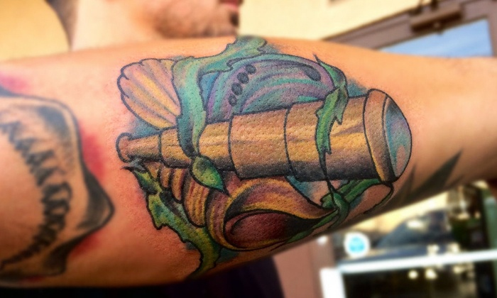 Lefty's Tattoo - Orange: Tattooing at Lefty's Tattoo (50% Off). Two Options Available.