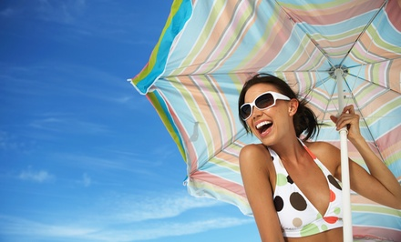 Five Spray Tans or Two Weeks of Tanning in a Level 1 or 4 Bed at Bahama Breeze Tanning Salon (Up to 71% Off)