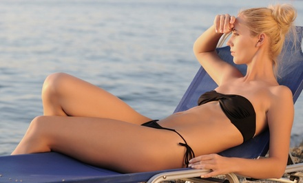 $26 for 7 Days of UV Tanning, 2 Mystic HDs, or 1 Organic Spray Tan at NY Sun Club (Up to $175 Value)