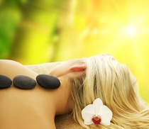 ST. AUGUSTINE FACE AND BODY: 60-Minute Hot Stone Massage and Consultation from ST. AUGUSTINE FACE AND BODY (55% Off)