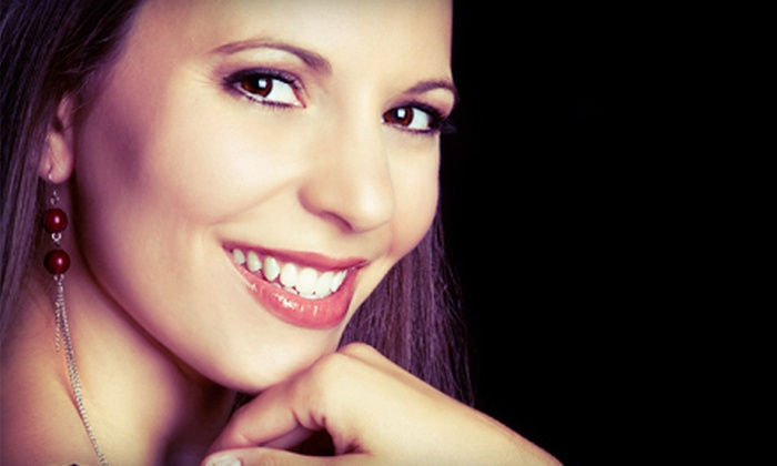 iSmile Dentistry - Multiple Locations: Dental-Exam Package with X-rays and Cleaning, or One Year of Dental Care at iSmile Dentistry (Up to 90% Off)