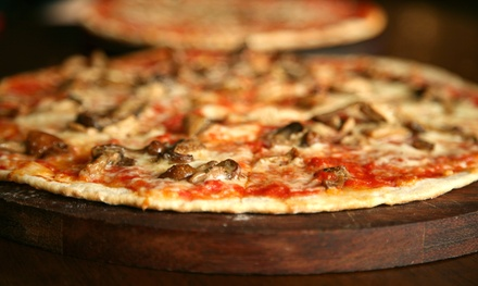 Pizza Packages with Options for Soda, Subs, and Salad at Taranto's Pizza (Up to 43% Off). Four Options Available.