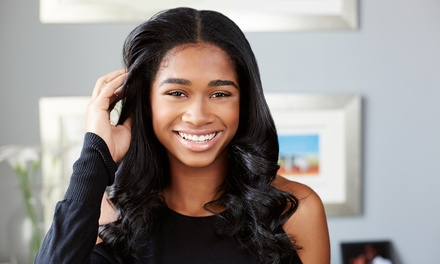 Silk Press, Crochet Braid, or Sew-In at Legendz Barber and Beauty Salon (Up to 41% Off)