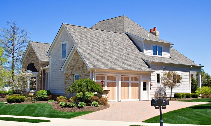 NuHome Exteriors - Washington DC: Siding or Window Replacement from NuHome Exteriors (Up to 67% Off)