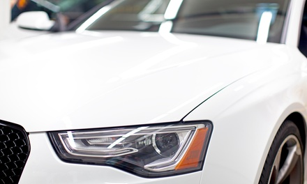 Headlight Restoration or Windshield Replacement at American Collision (Up to 76% Off)