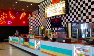 $11 for Two Movie Tickets with One Large Drink and One Large Popcorn at Village 8 Movies ($16 Value)