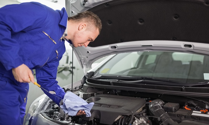 Dignity Auto Repair and Services - Downtown Toronto: Synthetic or Regular Oil Change with Fluid Top-Off at Dignity Auto Repairs and Services (Up to 54% Off)