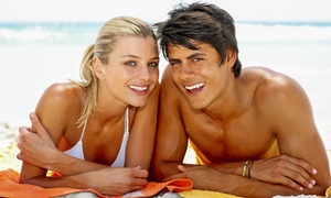 Darque Tan: Five UV-Tan Sessions in Five Levels of Beds or One VersaSpa or Norvell Spray Tan at Darque Tan (Up to 83% Off)