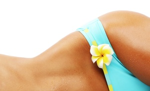 The Spot Hair Salon and Spa: One or Three Spray Tans with Fragrance and Shimmer at The Spot Hair Salon and Spa (50% Off)