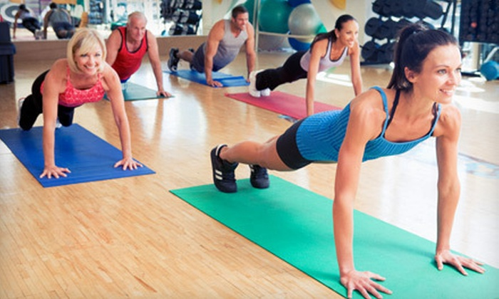 JKM Fitness - Midtown South Central: 20 or 10 Yoga, Pilates or Fitness Classes at JKM Fitness. Personal-Training Option Available (90% Off).