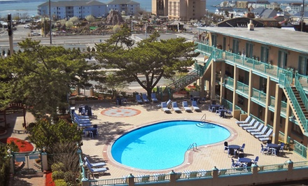 groupon daily deal - Stay at Days Inn Oceanfront in Ocean City, MD. Dates Available into June.