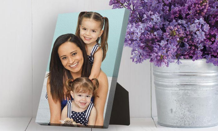 "JCPenney Portraits - Multiple Locations: Photo Shoot with 5""x7"" or 8""x10"" Canvas Display at JCPenney Portraits (Up to 85% Off)"