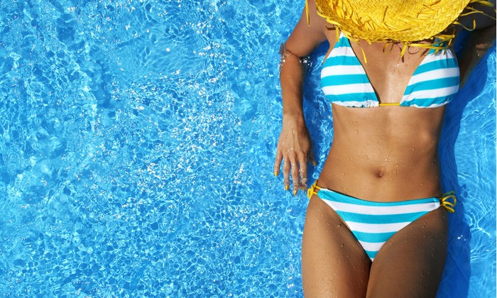 South Beach Tans - Golden Triangle: One or Three Airbrush Tans or One Month of UV Tanning at South Beach Tans (Up to 60% Off)