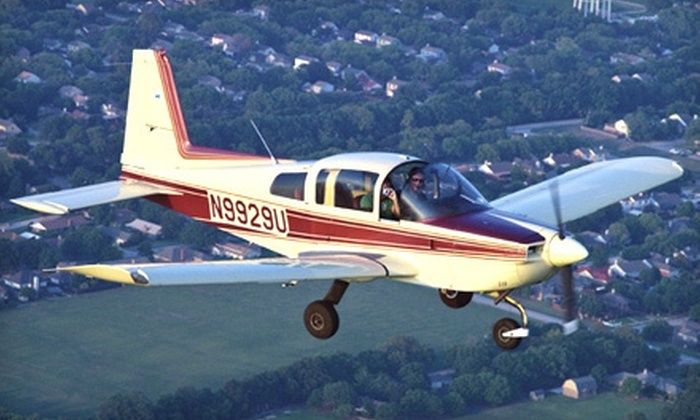Slipstream Aviation - Redbird: Super-Sized Discovery Flight or Private Pilot-Training Package from Slipstream Aviation (Up to 48% Off)