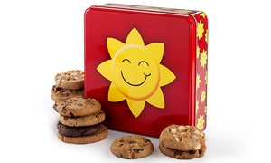 Mrs. Fields: One Dozen Cookies in a Gift Tin or One 16-Inch Customizable Cookie Cake from Mrs. Fields (Up to 48% Off)