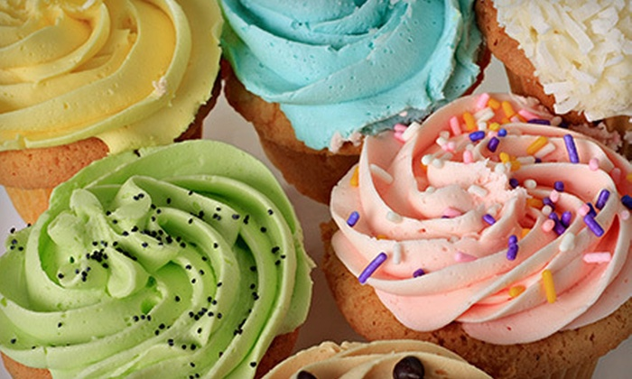 The GingerBread Girl - Beacon Square: One or Two Dozen Cupcakes with Fillings and Toppings at The GingerBread Girl (57% Off)