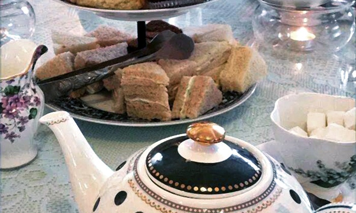 McKenna Tea Cottage - Seal Beach: Three-Course Afternoon Tea with Scones and Sandwiches for Two or Three at McKenna's Tea Cottage (50% Off)