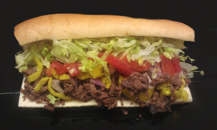 Full O Bull Subs & Pizza - Fresno: 2 Large Subs & Drinks or 2 Extra-Large Take-and-BakePizzas at Full O Bull Subs & Pizza Subs (Up to 50% Off)