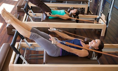 image for Four or Eight Reformer Pilates Sessions for Up to Four at Birmingham Pilates Studios (Up to 70% Off)