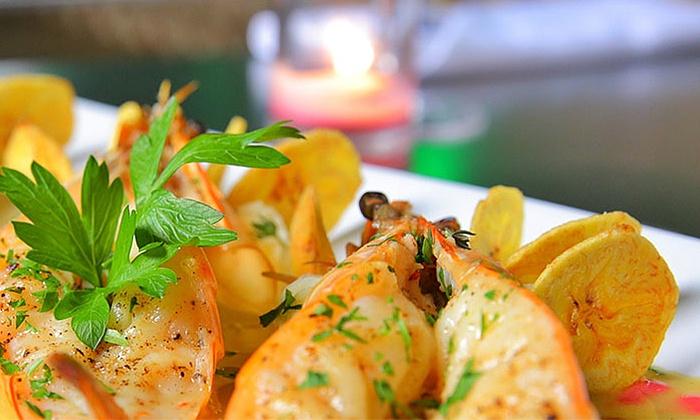 Vacca Grill & Lounge - Inwood: Latin-Influenced New American Meal with House Sangria for Two or Four at Vacca Grill & Lounge (Up to 61% Off)