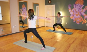Mind Body & Pilates: 5 or 10 Group Mat Pilates and/or Yoga Classes at Mind Body & Pilates (Up to 58% Off)