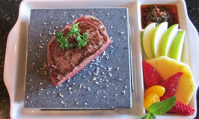 Cork N Brew Bistro - Clearwater: Lava-Rock Meal with Wine and Dessert for Two or Four at Cork N Brew Bistro (Up to 48% Off)